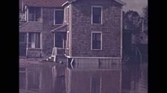 Vintage 16mm film, USA 1945, hurricane aftermath flood and damaged homes  Arkistovideo