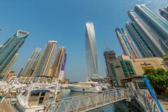 Dubai - AUGUST 9, 2014: Dubai Marina district on August 9 in UAE. Dubai is - stock photo