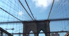 4K - Car drives along the Iconic Brooklyn Bridge arriving in NYC Stock Footage