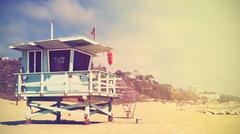 Retro stylized lifeguard tower in Santa Monica at sunset, USA. - stock photo