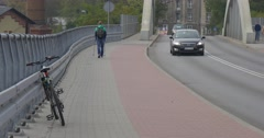People Walk On The Sidewalk Woman Rides On The Bicycle Different Passenger Cars - stock footage
