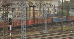 People Goods Train Arrives Wagons Buildings Residental Houses behind the Fence Stock Footage