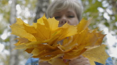 The process of weaving a wreath of maple leaves Stock Footage