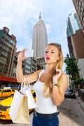 Blond tourist girl selfie photo in New York 5th ave - stock photo