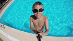 Boy jumps into pool - stock footage