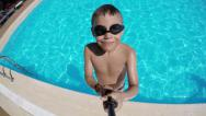 Stock Video Footage of Boy jumps into pool