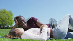 Romantic couple relaxing in the park on a sunny day. Stock Footage