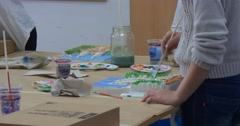 Teachers Teenagers Hands Close Up with Brushes are Painting at the Table Stock Footage