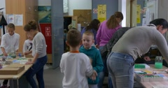 Group of Children Teenagers and Young Adult Teachers at the Workshop Children Stock Footage