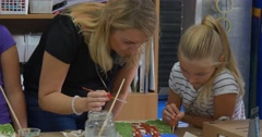 Blonde Woman And Teenage Girl Close Up Brushes in the Pot Children Are Painting Stock Footage