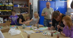 Group of Children Teachers Parents at Workshop Help the Children to Paint Stock Footage