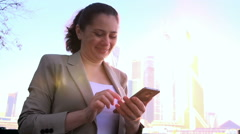 Business girl writing a message on your smartphone Stock Footage
