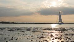 Sailboat crossing the horizon on the Walton Channel Stock Footage