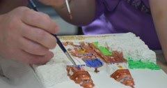 Girl's And Teacher's Hands With Brushes Close Up Children Are Painting The Stock Footage