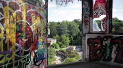 Aerial view of forest from an abandoned building full of graffiti - stock footage