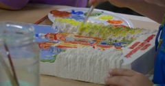 Child Hand with Brush Yellow Paint Children Are Painting The Cathedral Katedra Stock Footage