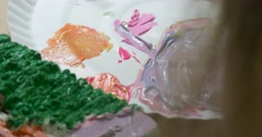 Girl's Picture is Ready Palette Close Up Little Blonde Girl is Painting Picture Stock Footage