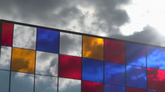Outdoor stained-glass window on public square, cloudy sky background - zoom out Stock Footage