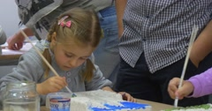 Girl Close Up is Painting with Brush Children Are Creating Hand-Made Products Stock Footage