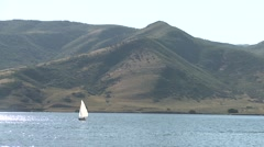 Fisherman fishing in a sailboat - stock footage