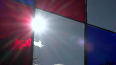 Sun throught stained-glass window on public square - zoom out 2 Stock Footage