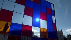 Sun throught stained-glass window on public square - zoom out Stock Footage