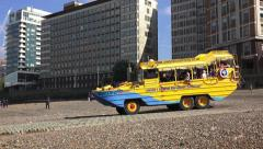 A DUK-W (in 4k) tourist touring bus entering the River Thames, London, UK. Stock Footage