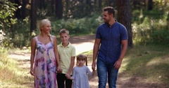 Family walking in the woods Stock Footage