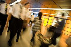Customs officers and travellers in an airport Stock Photos