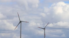 Wind turbines against cloudy blue sky, wind wheels Stock Footage