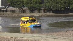A DUK-W (in 4k) tourist touring bus exiting the River Thames, London, UK. Stock Footage
