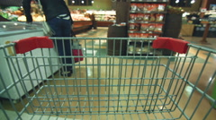 July 15th 2015, Seven-Island, Canada. Detail of Grocery Store Cart Moving inside - stock footage