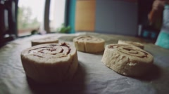 Point of view: cinnamon rolls being put into the hot oven. Slow Motion. Stock Footage