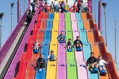 People enjoying a giant slide Stock Photos