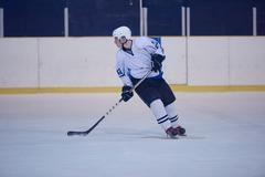 ice hockey player in action - stock photo