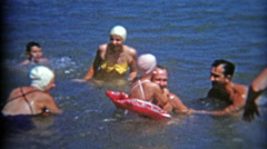 1953: Ladies all having swim caps when at the beach. Stock Footage
