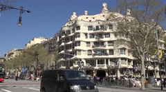 4K Famous Casa Mila traffic car avenue Barcelona cultural place Catalonia emblem Stock Footage