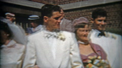 1953: Wedding pictures with folks lined up for the big photograph. - stock footage