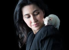 Woman in Black with White Rat - stock photo