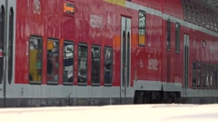 4K Germany train rail station local transportation people commute travel journey Stock Footage