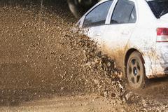 Mud debris splash from a rally car ( Focus at mud debris) - stock photo