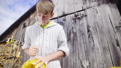 Boy in front of wooden door cutting out pumpkin 4K Stock Footage