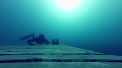 Freediver crawling Underwater on a Wood Platform Stock Footage