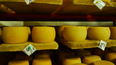 Cheeses stored on wooden shelves Stock Footage