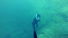 Freediver Resurfacing after a deep Dive - stock footage