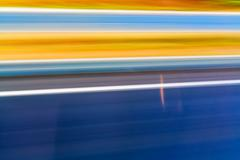 Stock Photo of Colorful blured motion background blue yellow orange blurry