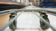 Detail of the Wheels of a Grocery Store Cart Stock Footage