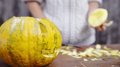 Measuring a hat for scary pumpkin face 4K - stock footage
