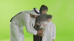 Emirati family with incense burner Stock Footage