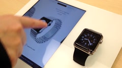 Woman playing new iwatch inside Apple store Stock Footage